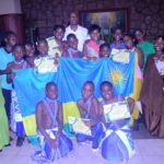 Group photo of Rwandan children after dinner with their ambassador